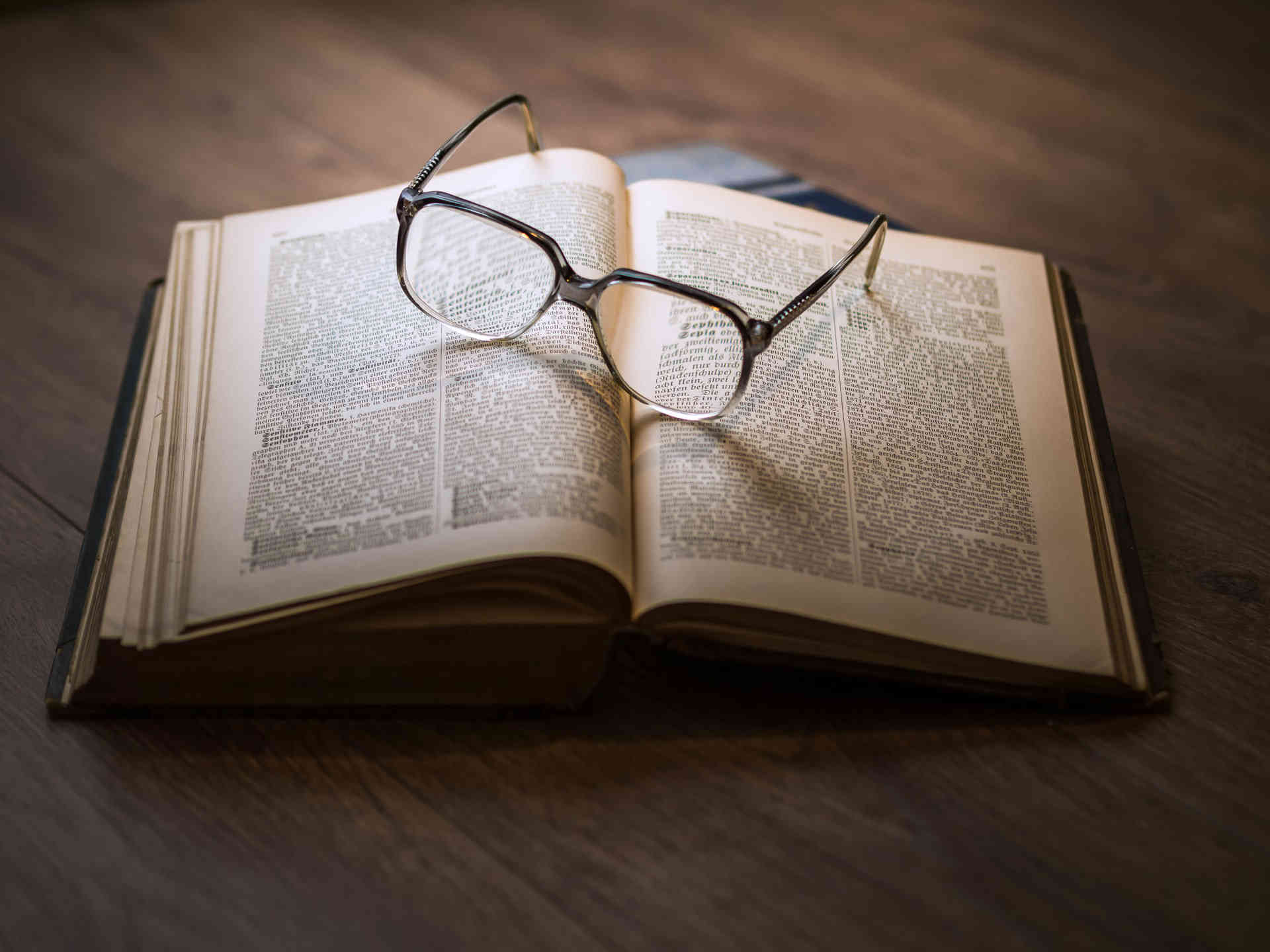 Open book with glasses